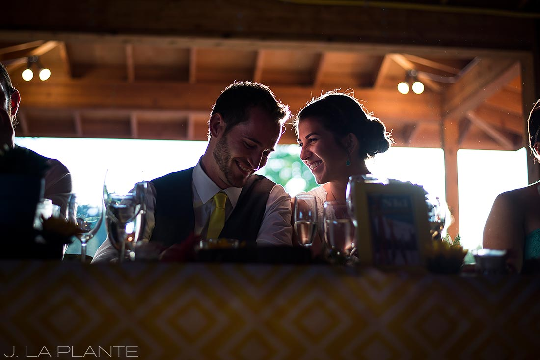J. La Plante Photo | Boulder Colorado Wedding Photographer | Planet Bluegrass Wedding | Bride and Groom Listening to Speeches