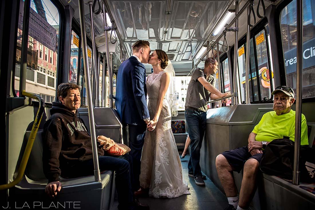 J. La Plante Photo | Denver Wedding Photographer | Grand Hyatt Denver Wedding | Bride and Groom Riding City Bus