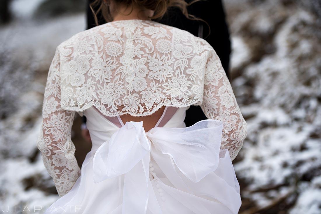 Bride and groom walking in snowy woods | Chief Hosa Lodge wedding | J. La Plante Photo | Denver Wedding Photographers