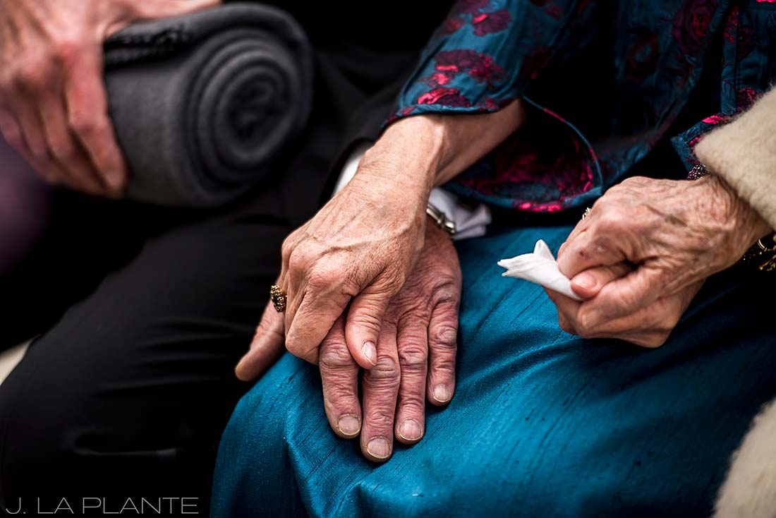 Bride's parents holding hands | Chief Hosa Lodge wedding | J. La Plante Photo | Denver Wedding Photographers