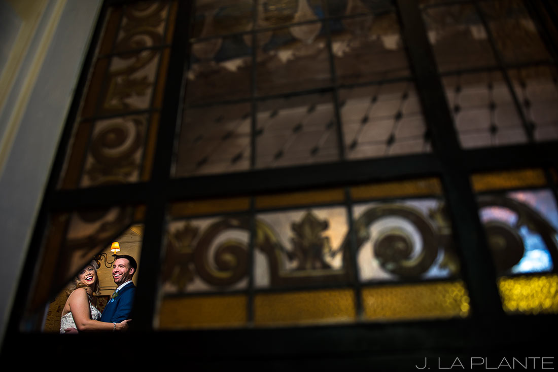 Bride and groom through stained glass | Race & Religious Wedding | New Orleans Destination Wedding Photography | J. La Plante Photo