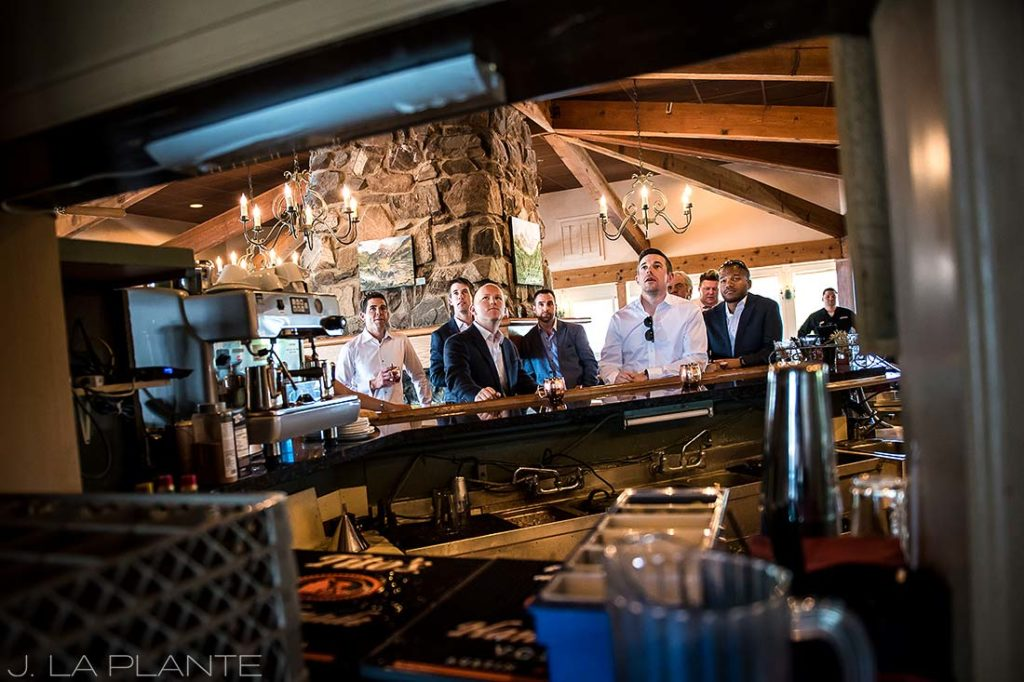 Mount Vernon Country Club Wedding | Groomsmen watching football | Denver wedding photographer | J La Plante Photo