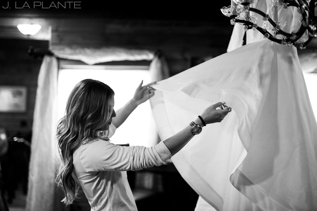 bride getting into wedding dress before ceremony