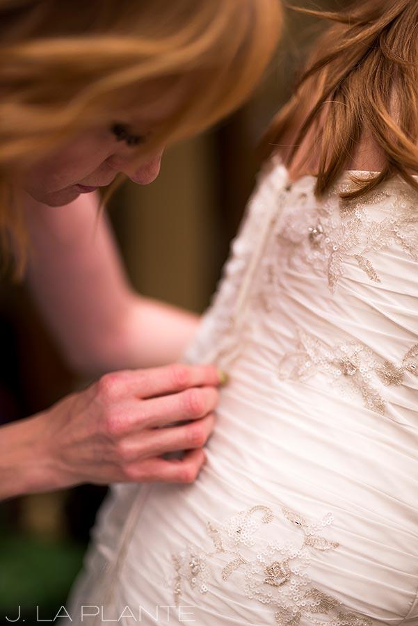 Mount Vernon Country Club Wedding   Bride getting into dress   Denver wedding photographer   J La Plante Photo