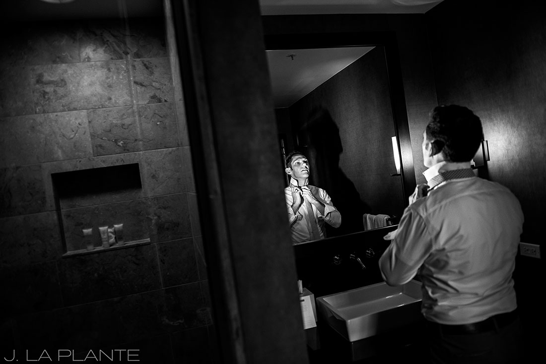 Grand Hyatt Denver Wedding   Bridesman adjusting tie   Same Sex Wedding Photographer   J La Plante Photo