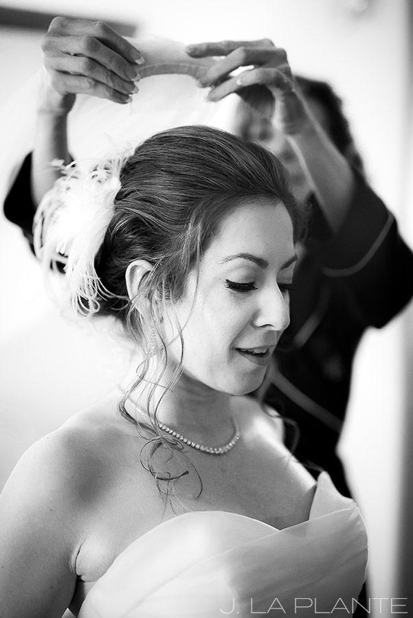 Sonnenalp Wedding | Bride putting veil on | Vail wedding photographer | J La Plante Photo