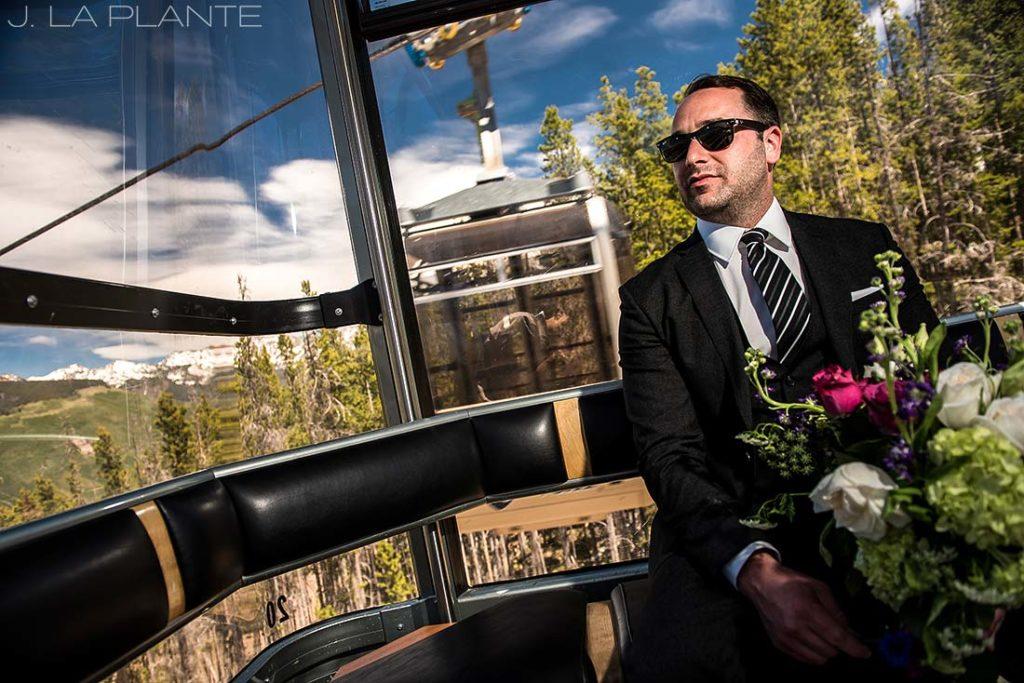 groom riding on gondola