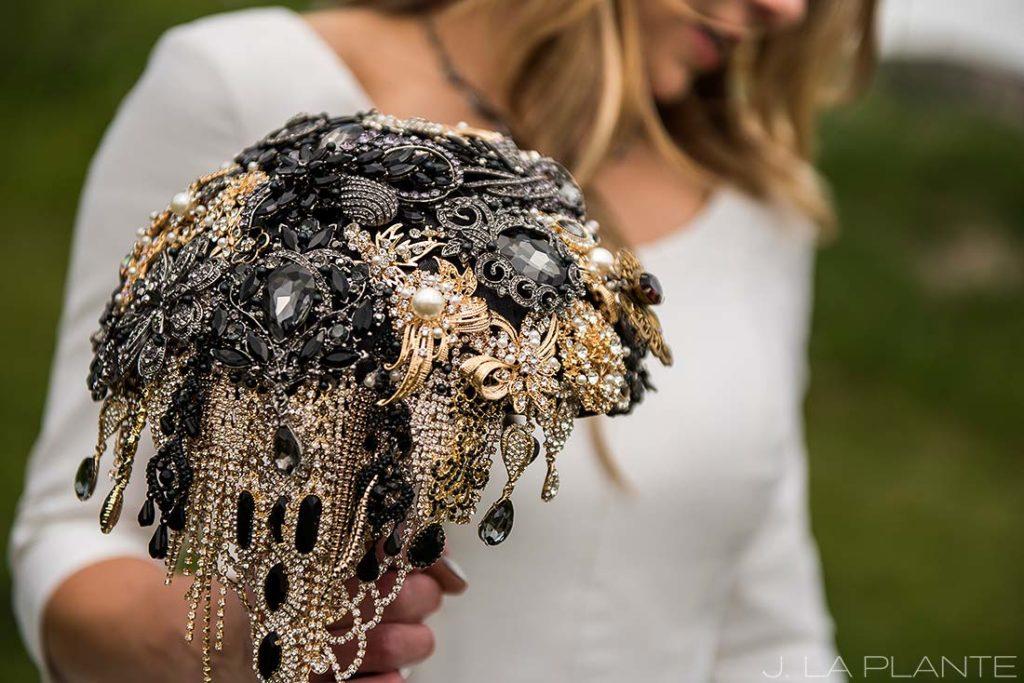 bride holding unique brooch bouquet