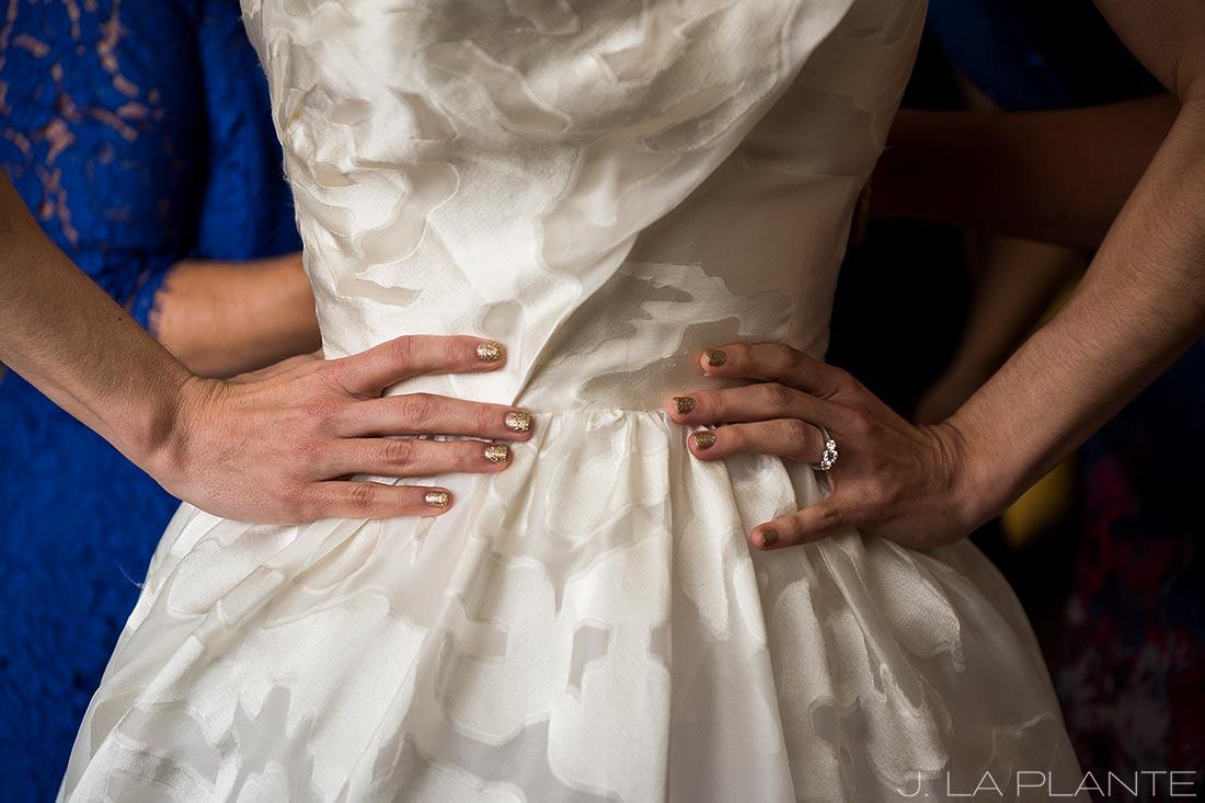 Grand Hyatt Denver Wedding   Bride getting into dress   Same Sex Wedding Photographer   J La Plante Photo