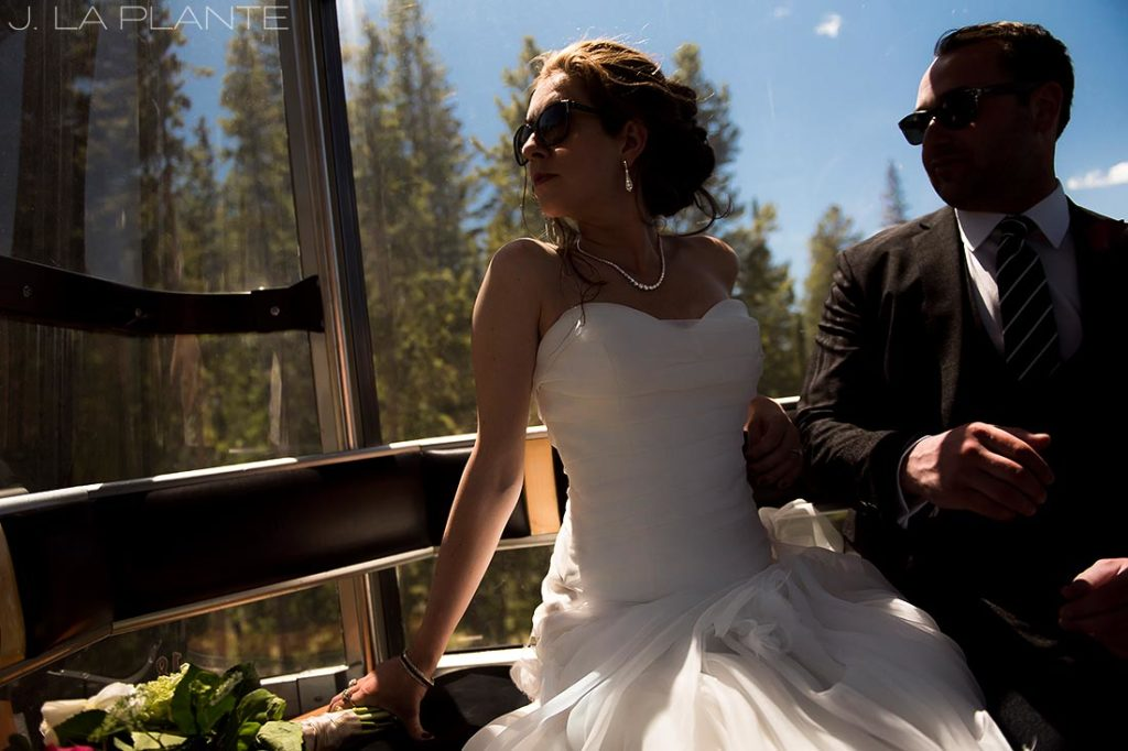bride and groom riding on gondola