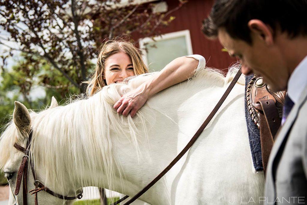 Bride on horse   Crooked Willow Farms Wedding   Denver Wedding Photographer   J La Plante Photo