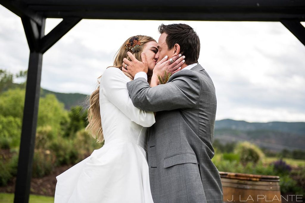 Romantic first kiss as husband and wife   Crooked Willow Farms Wedding   Denver Wedding Photographer   J La Plante Photo