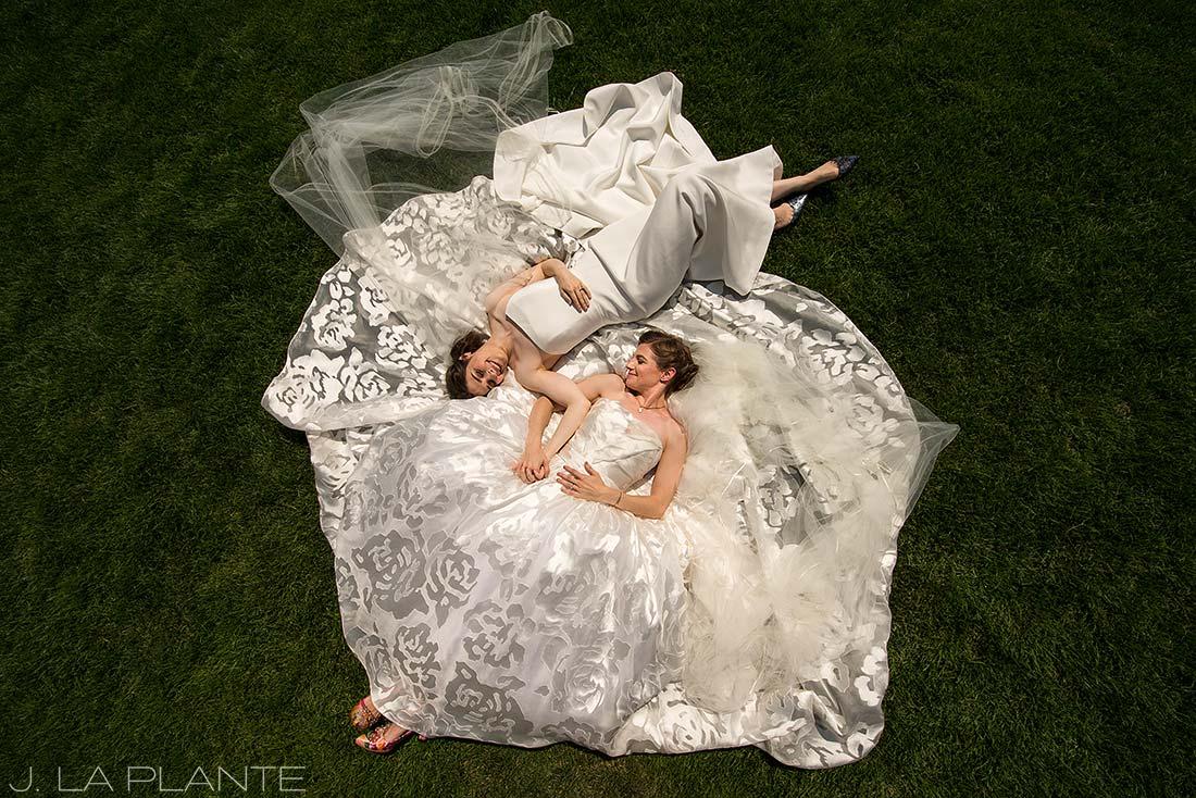 Denver Botanic Gardens Wedding   Brides lying on wedding dress   Same Sex Denver Wedding Photographer   J La Plante Photo