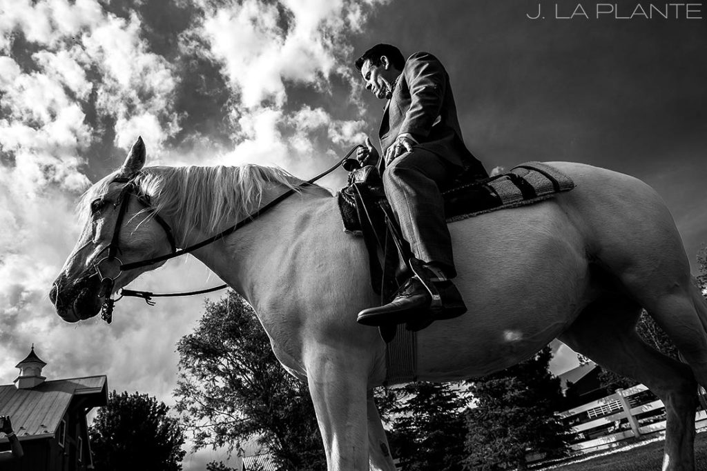 groom riding a horse during wedding ceremony