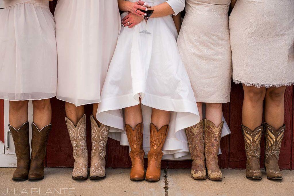 Bridesmaids in cowboy boots   Crooked Willow Farms Wedding   Denver Wedding Photographer   J La Plante Photo