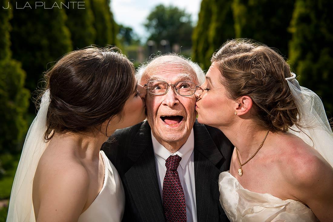 Denver Botanic Gardens Wedding   Brides kissing grandpa   Same Sex Wedding Photographer   J La Plante Photo
