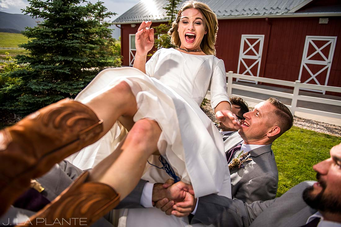 Groomsmen tossing bride in the air | Crooked Willow Farms Wedding | Denver Wedding Photographer | J La Plante Photo