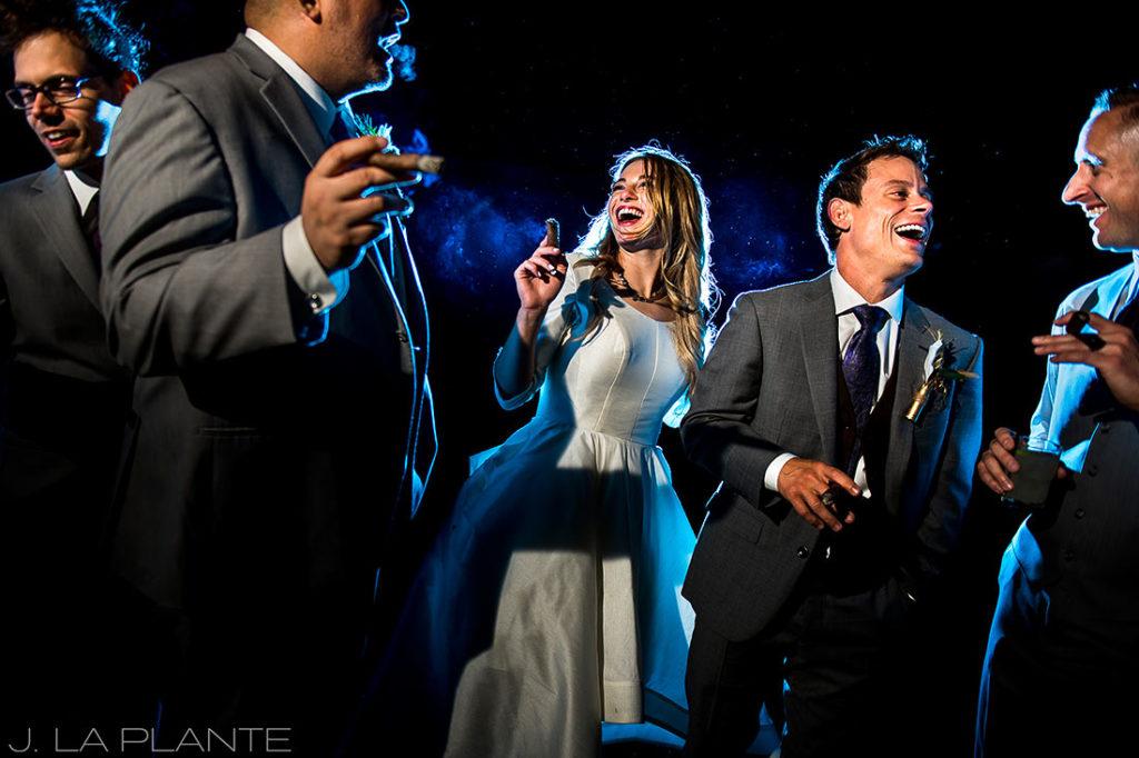 Bride smoking cigar   Crooked Willow Farms Wedding   Denver Wedding Photographer   J La Plante Photo