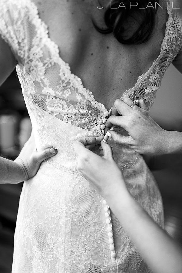 Edgewood Inn Wedding   Colorado Springs Wedding Photographer   Bride getting into dress   J La Plante Photo