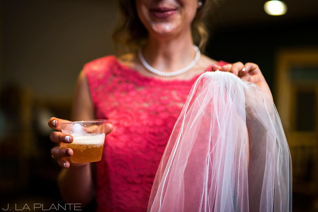 Edgewood Inn Wedding   Colorado Springs Wedding Photographer   Bridesmaid with veil and champagne   J La Plante Photo