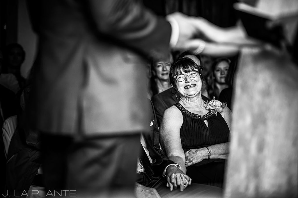 mother of the bride laughing during ceremony