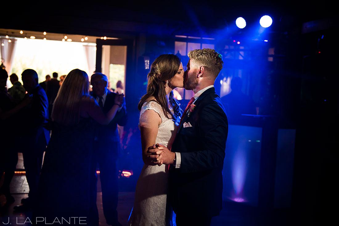 Edgewood Inn Wedding   Colorado Springs Wedding Photographer   Bride kissing groom on dance floor   J La Plante Photo