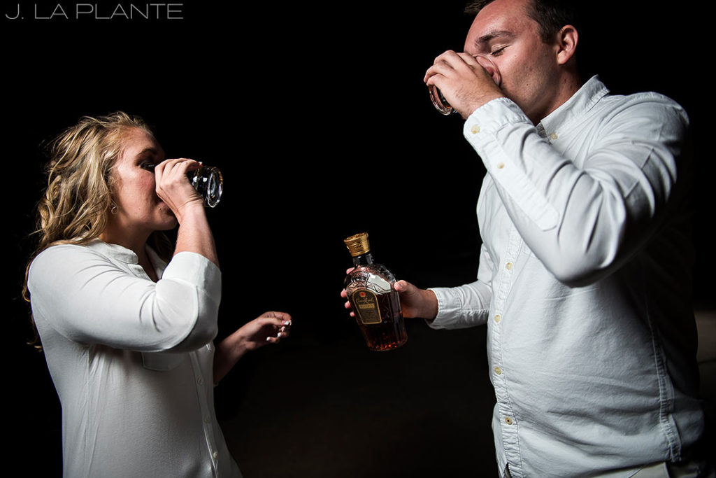 bride and groom to be drinking whiskey before photo session