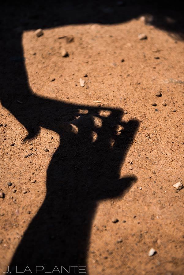 Solar eclipse engagement shoot | Eclipse shadows made by hands | Vail engagement photographer | J La Plante Photo