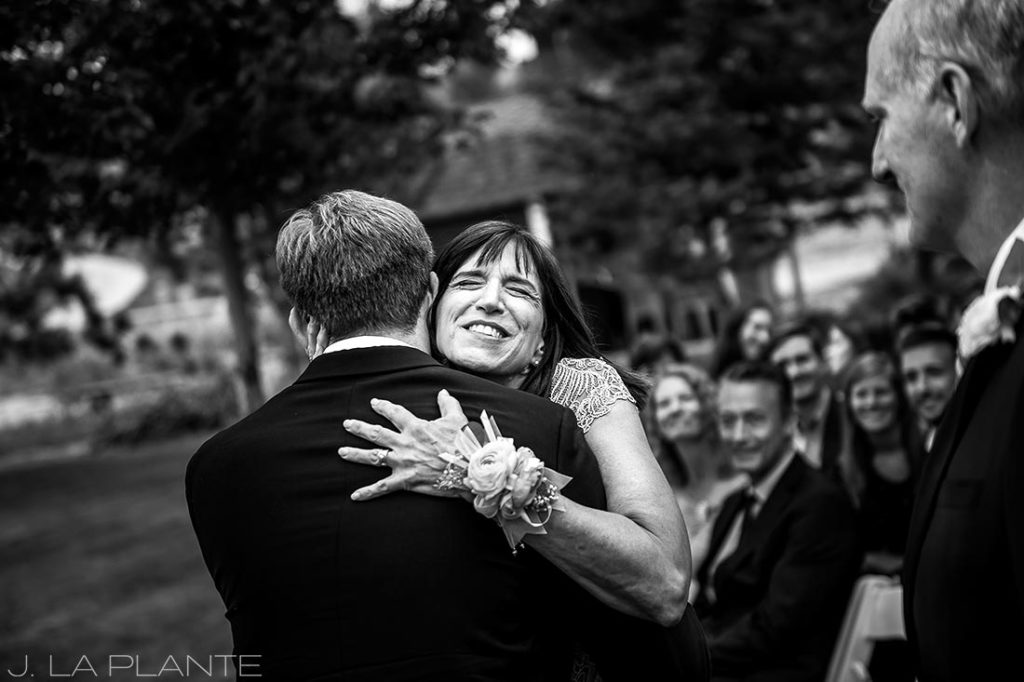 mother of the groom hugging her son