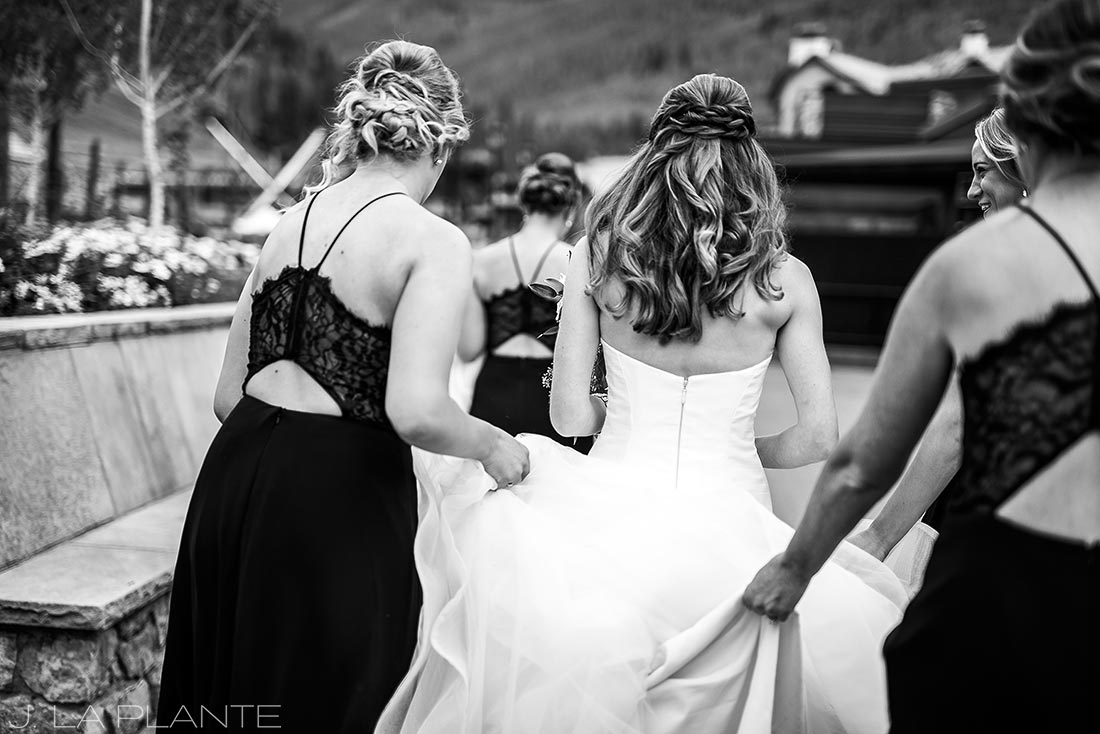 Beaver Creek Wedding deck ceremony | Bride and bridesmaids walking to ceremony | Beaver Creek wedding photographer | J La Plante Photo