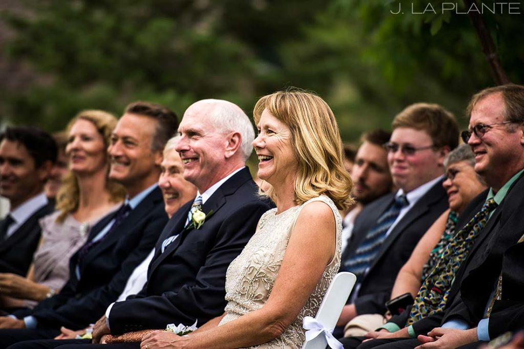 parents of the bride laughing during wedding ceremony