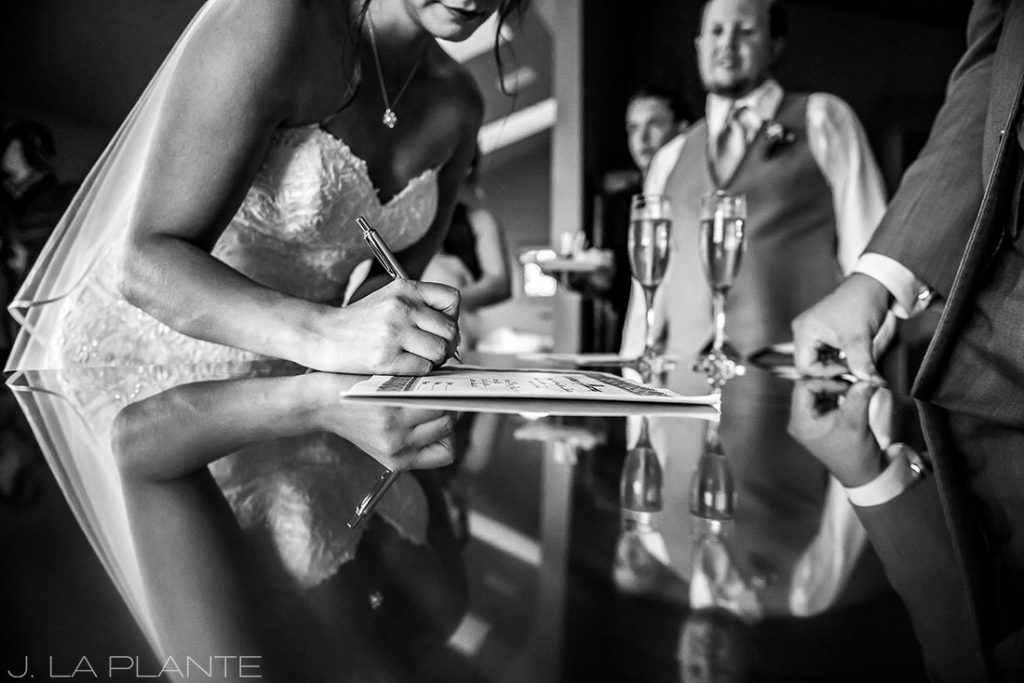 bride signing the marriage license