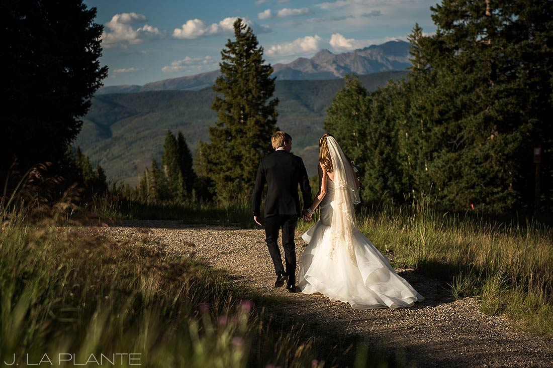 Beaver Creek Wedding | Bride and groom in field in mountains | Beaver Creek wedding photographer | J La Plante Photo