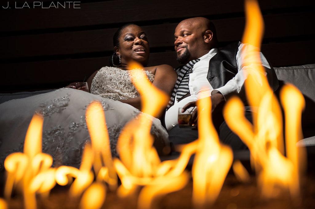JW Marriott Cherry Creek Wedding | Bride and groom by fire | Denver wedding photographer | J La Plante Photo