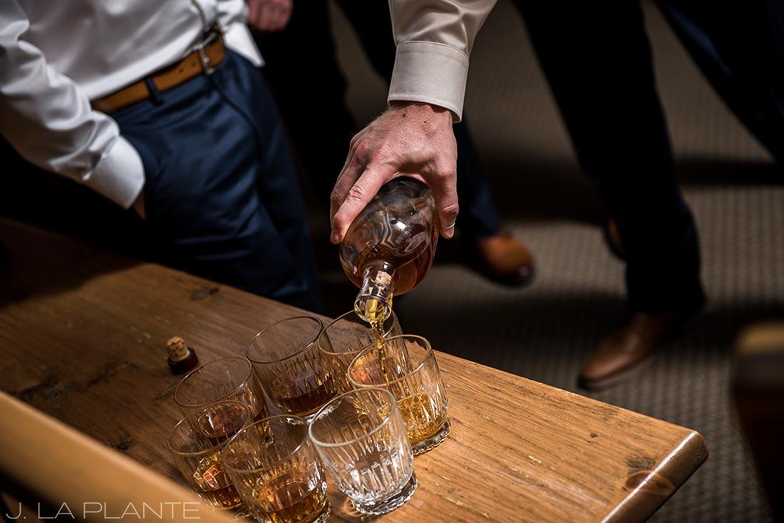 Fall Copper Mountain Wedding | Groom pouring whiskey | Colorado Destination Wedding Photographer | J La Plante Photo