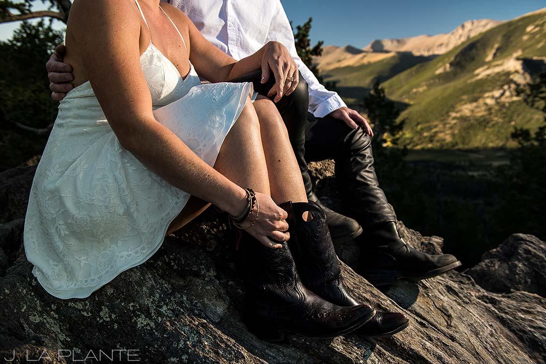 Rocky Mountain National Park Elopement | Bride and groom sitting on rocks | Colorado Elopement Photographer | J La Plante Photo