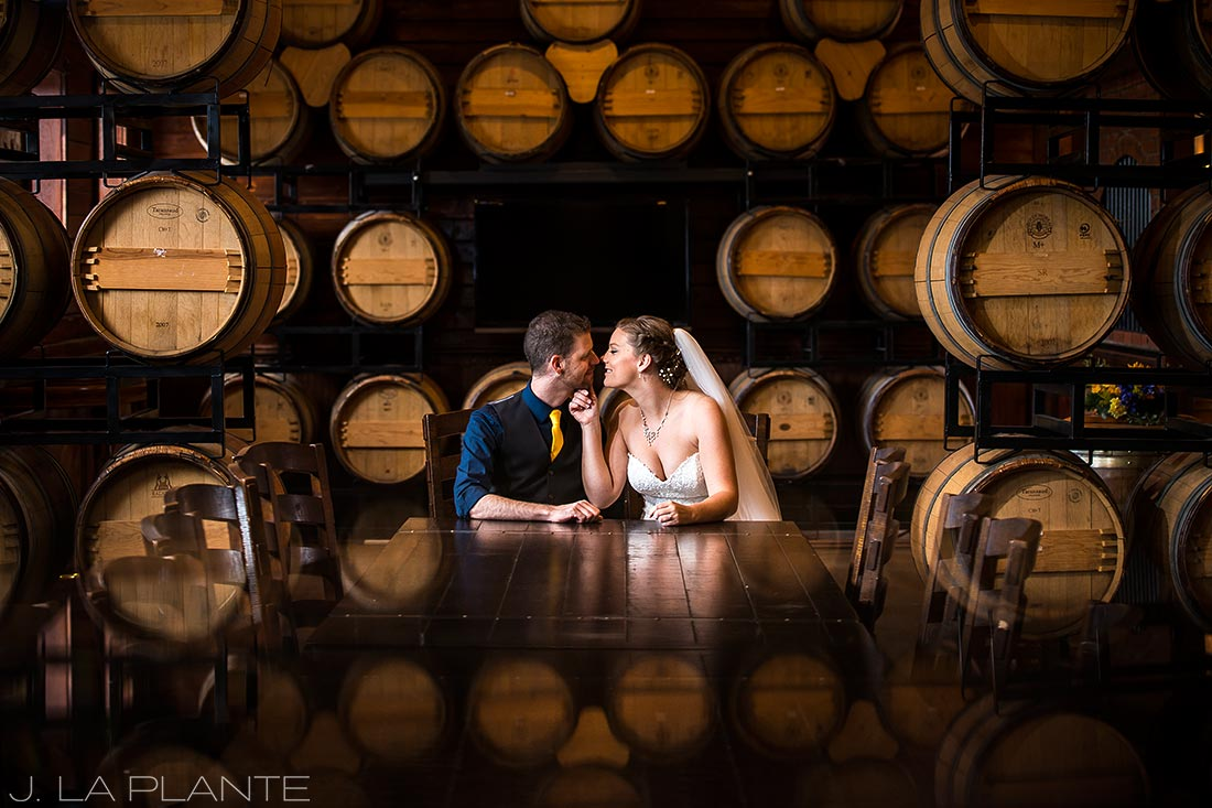 Crooked Willow Farms Wedding | Bride and groom in wine cellar | Colorado Wedding Photographer | J La Plante Photo