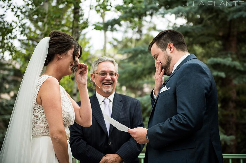 bride and groom crying during wedding ceremony