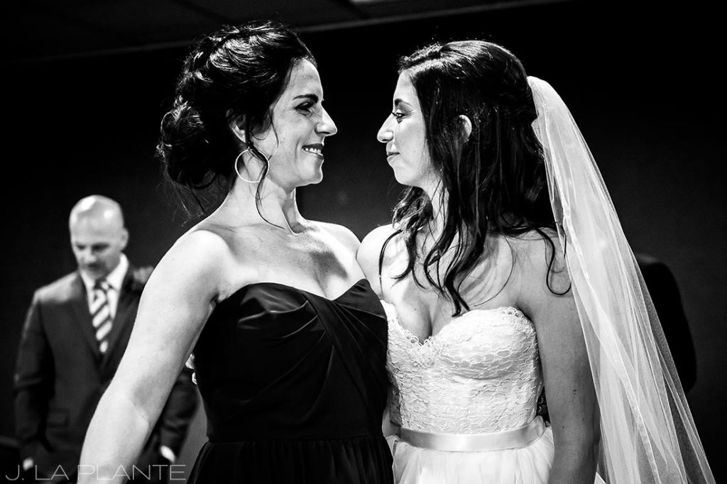 black and white photo of bride with her sister
