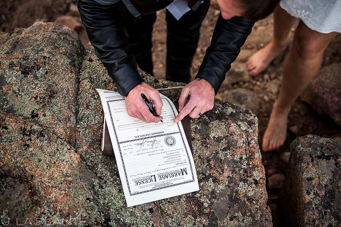 Rocky Mountain National Park Elopement | Signing the marriage license | Colorado Elopement Photographer | J La Plante Photo