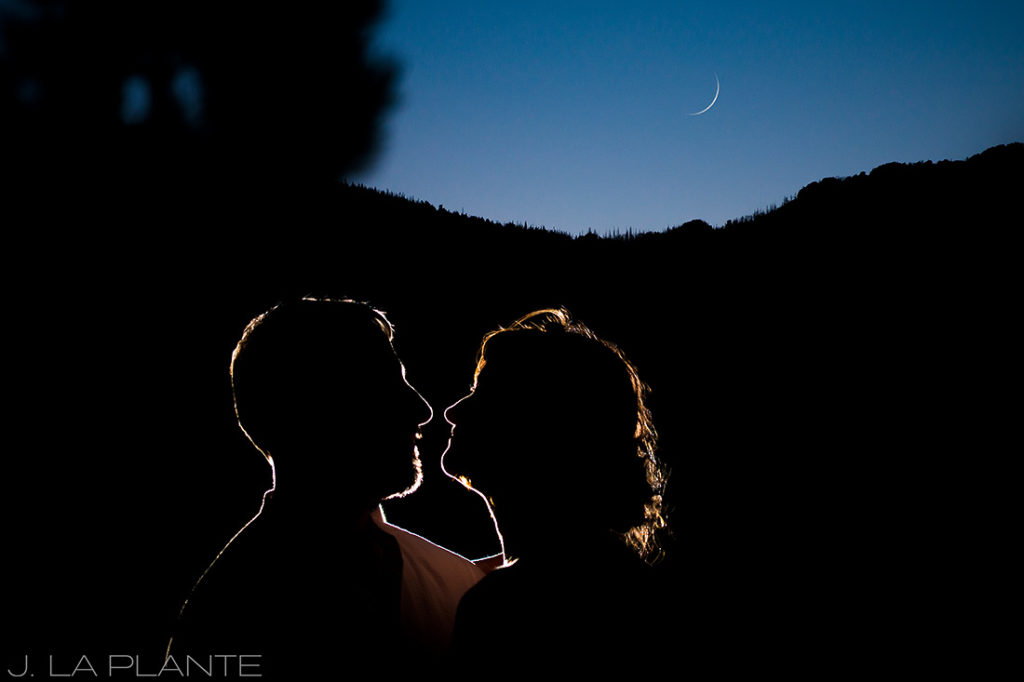cool photo of bride and groom with the moon