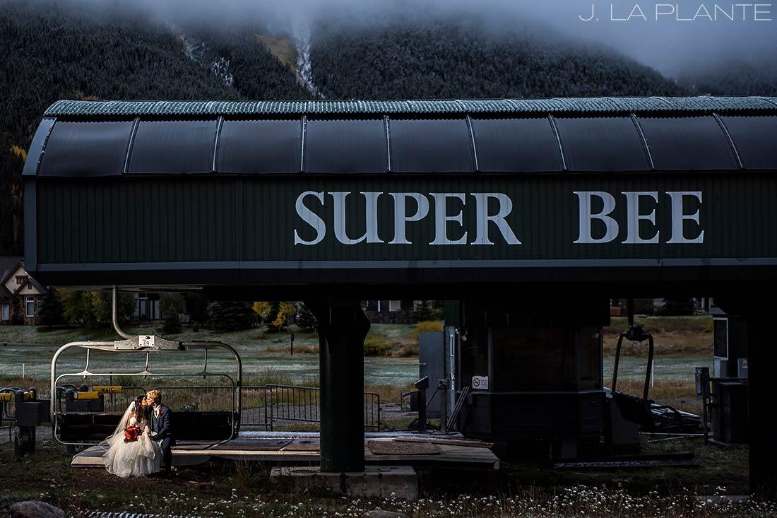 Fall Copper Mountain Wedding | Bride and groom on chairlift | Colorado Destination Wedding Photographer | J La Plante Photo