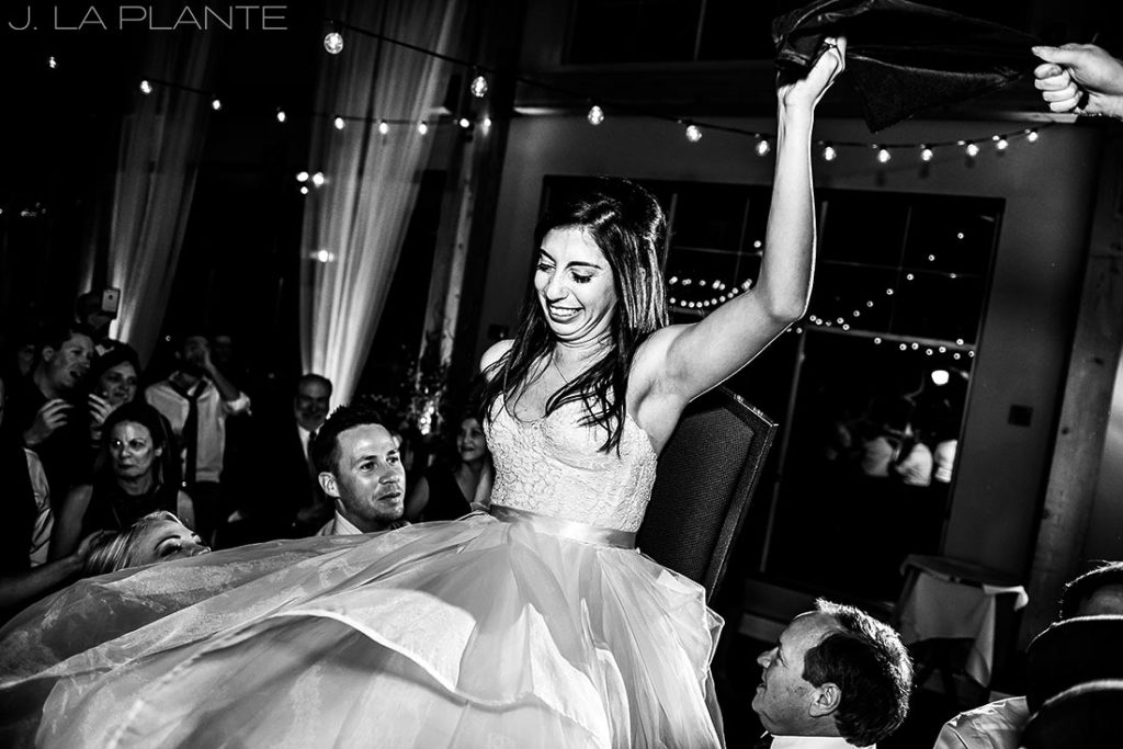 wedding guests lifting bride into the air