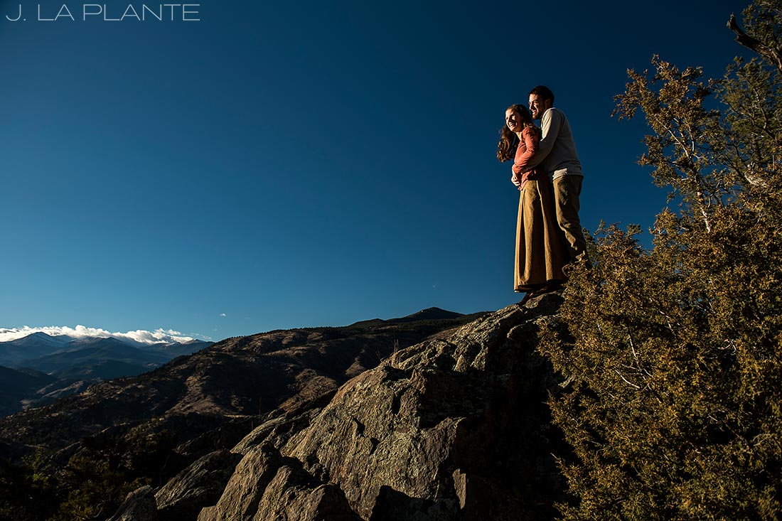 bride and groom to be hiking on rock formations