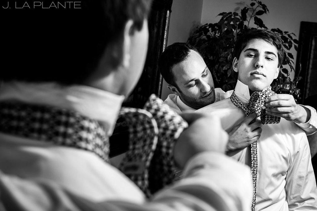 Willow Ridge Manor Wedding | Groom with helping brother with tie | Denver wedding photographer | J La Plante Photo