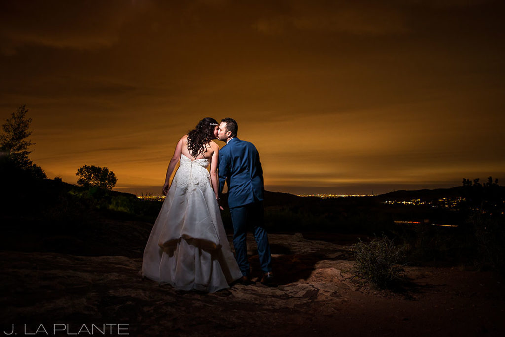 unique sunset wedding photo of bride and groom