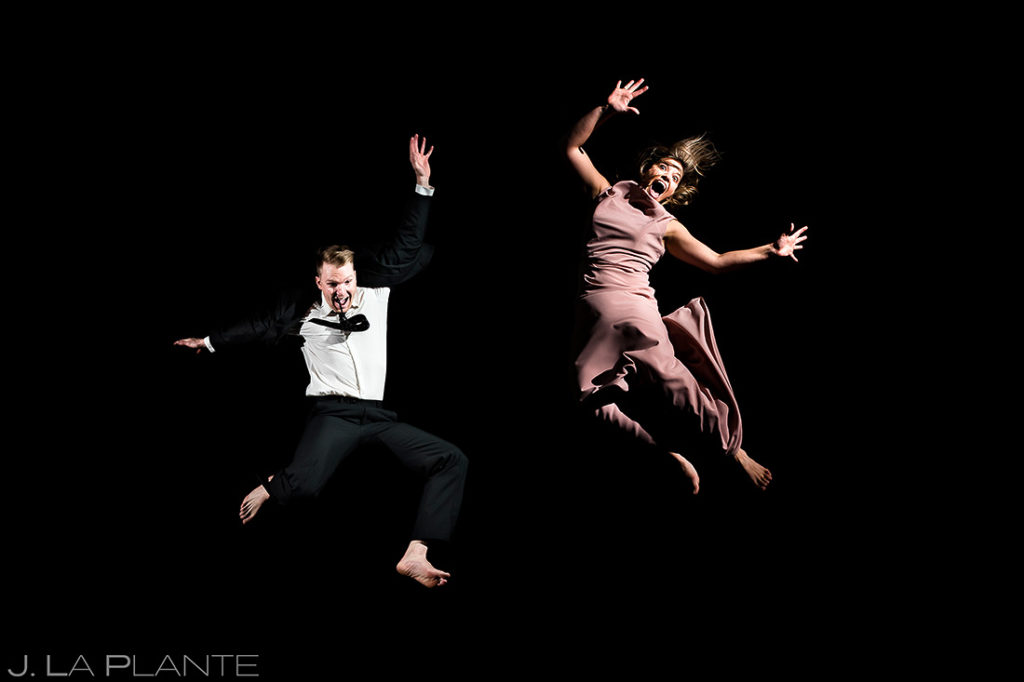 bride and groom jumping on trampoline