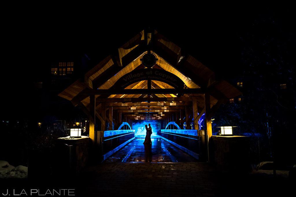 Bride and groom dancing on bridge | Christmas light engagement session | Copper Mountain engagement photographer | J L a Plante Photo
