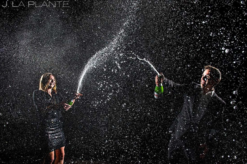 Bride and Groom Spraying Champagne | Classy Urban Engagement | Denver Wedding Photographers | J. La Plante Photo