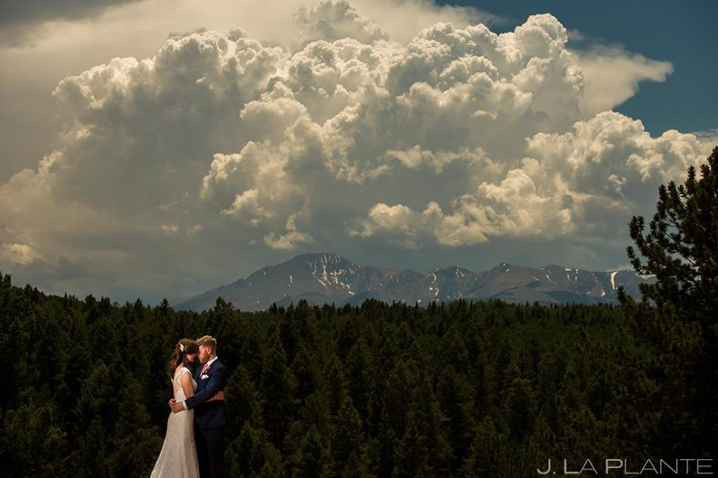 photo of bride and groom with pike's peak in the background